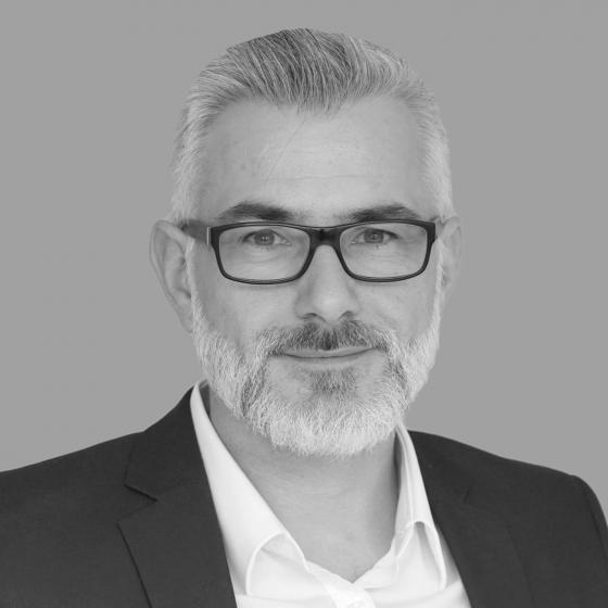 B/W headshot of Jeff Coatze, Managing Partner • MPK International • Johannesburg, South Africa